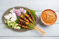 Malay chicken satay fresh on wooden dining table one of famous malaysian local dishes Royalty Free Stock Photos