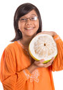 Malay girl and pomelo fruit iii asian young in a traditional dress the baju kurung with a half sliced Stock Image