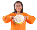 Malay girl and pomelo fruit vi asian young in a traditional dress the baju kurung with a half sliced Stock Photos