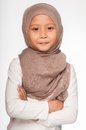 Malay little girl wearing head scarf as islamic attire Royalty Free Stock Photo
