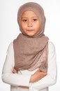 Malay little girl wearing head scarf as islamic attire Stock Image
