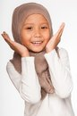 Malay little girl wearing head scarf as islamic attire Stock Photo