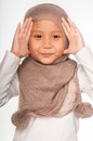 Malay little girl wearing head scarf as islamic attire Stock Photos