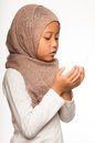 Malay little girl wearing head scarf as islamic attire Royalty Free Stock Photography