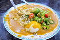 Malay mee rebus noodle dish garnished with cut chili peppers tofu chinese celery and hard boiled egg Stock Photography