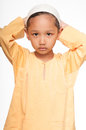 Malay muslim boy wearing islamic attire Royalty Free Stock Photo