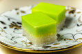Malay traditional dessert seri muka on a fancy plate also kuih or sri pretty face or kuih salat is two layered with steamed Royalty Free Stock Photo