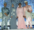 Malay wedding couples in traditional dress at wed Stock Photos