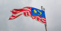 Malaysian flag ii a over a stormy cloud sky Royalty Free Stock Photography