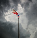Malaysian flag vi a over a stormy cloud sky Royalty Free Stock Image
