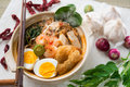 Malaysian food prawn mee noodles famous spicy fresh cooked har in clay pot with hot steam serve with chopsticks Stock Photos
