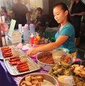 Malaysian girl selling local snacks at the night street food in Malacca Malaysia Royalty Free Stock Photo