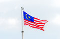 Malaysian national flag being blown by the wind Royalty Free Stock Image
