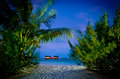 Maldives villas in the water palm view to beach at night Stock Photography