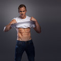 Male with abs lifting shirt up Royalty Free Stock Photo