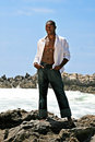 Male African American Model Posing on the Rock on Royalty Free Stock Photos