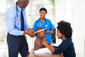 Male african doctor doing checkup baby boy office Royalty Free Stock Image