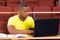 Male african university student laptop focused using Stock Photo