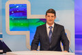 Male anchorman in tv studio live broadcasting Royalty Free Stock Photography