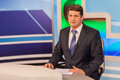 Male anchorman in tv studio. Live broadcasting Royalty Free Stock Photo