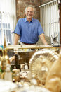 Male antique shop proprietor Stock Image
