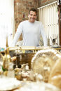 Male antique shop proprietor Royalty Free Stock Photography