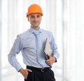 Male architect holding laptop young wearing helmet and Royalty Free Stock Photos