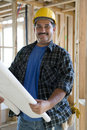 Male Architect Holding Unrolled Blueprint Stock Photos