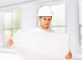 Male architect looking at blueprint at home Stock Images