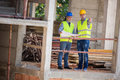 Male architects show building place to colleague Royalty Free Stock Photo