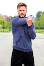 Male athlete doing stretch outside Royalty Free Stock Photo