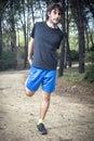 Male athlete doing stretching leg Royalty Free Stock Photo