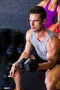 Male athlete exercising with dumbbell Royalty Free Stock Photo