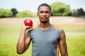 Male athlete holding shot put ball Royalty Free Stock Photo