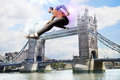 Male athlete hurdling tower bridge Royalty Free Stock Photos