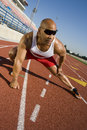 Male Athlete Warming Up On Race Course Royalty Free Stock Photo