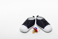 Male baby shoes and pacifiers Stock Images