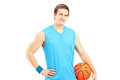 Male basketball player holding a ball isolated on white background Stock Photo