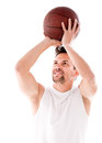 Male basketball player shooting the ball isolated over black Royalty Free Stock Images