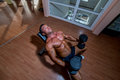 Male bodybuilder resting after doing heavy weight exercise Stock Photos