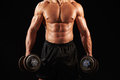 Male bodybuilder working out with heavy dumbbell, crop Royalty Free Stock Photo