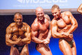 Male bodybuilders flex their muscles and show their best physiqu maastricht the netherlands october physique on stage at the world Stock Image
