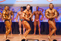 Male bodybuilders flex their muscles to show their physique maastricht the netherlands october and shows best chest pose on stage Stock Image