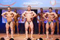Male bodybuilders flex their muscles to show their physique maastricht the netherlands october and shows best lats spread front Stock Image
