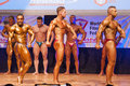 Male bodybuilders flex their muscles to show their physique maastricht the netherlands october and shows best side pose on stage Stock Photos