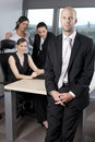 Male boss standing in front of his collegues Royalty Free Stock Photos