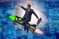 The male businessman flying on rocket in business concept