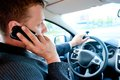 Male  businessman talking on a cell phone while driving Royalty Free Stock Photo