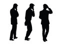 Male businessman thinks goes black silhouette figure Royalty Free Stock Photo