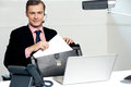 Male call centre executive arranging paper works Royalty Free Stock Photo
